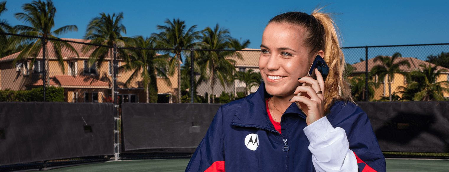 Sofia Kenin using an Motorola razr smartphone