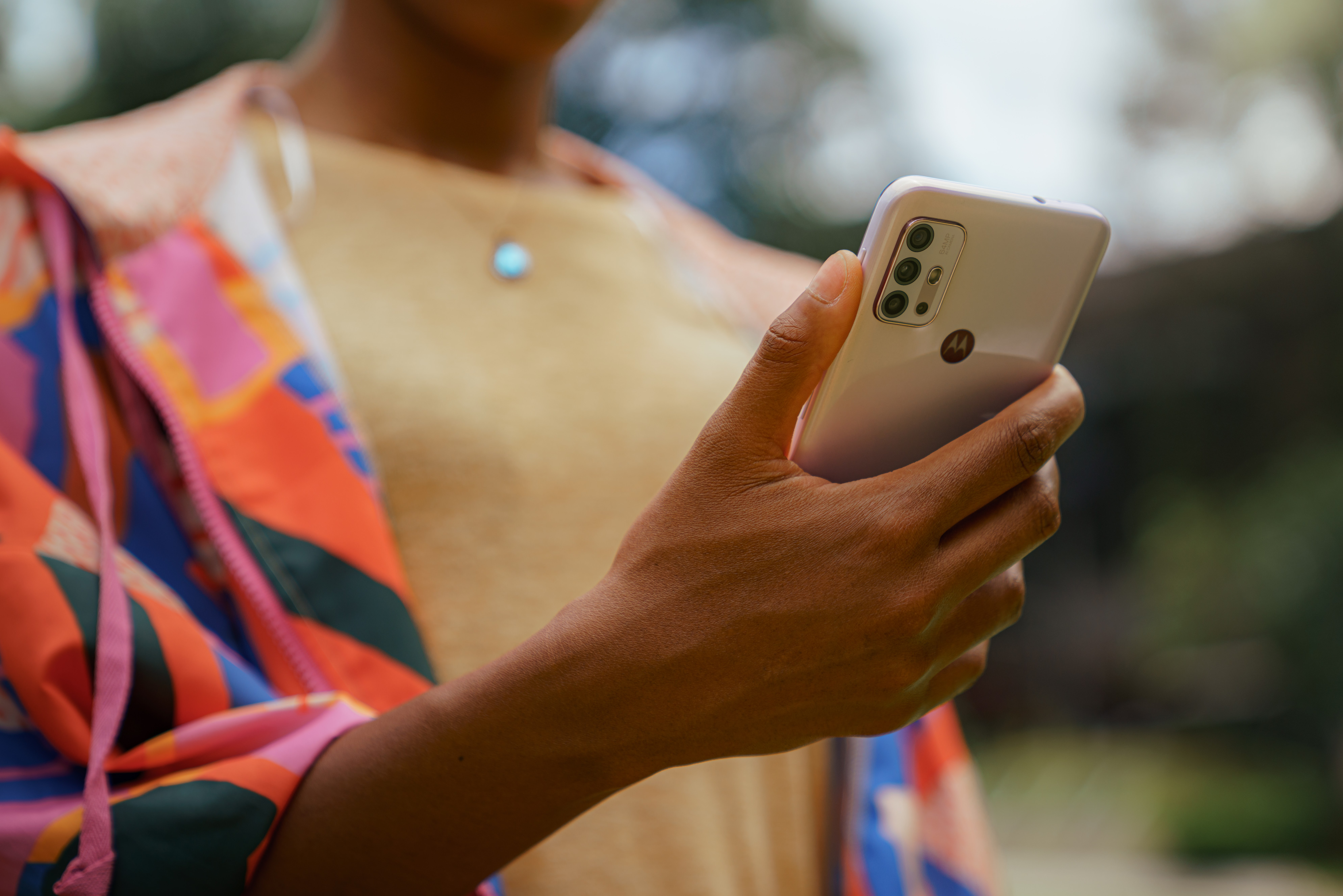 image of person holding a moto g30