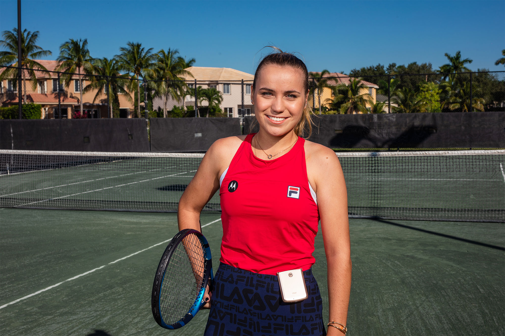 "Sofia Kenin wearing the Motorola ""batwing"" logo on her uniform"