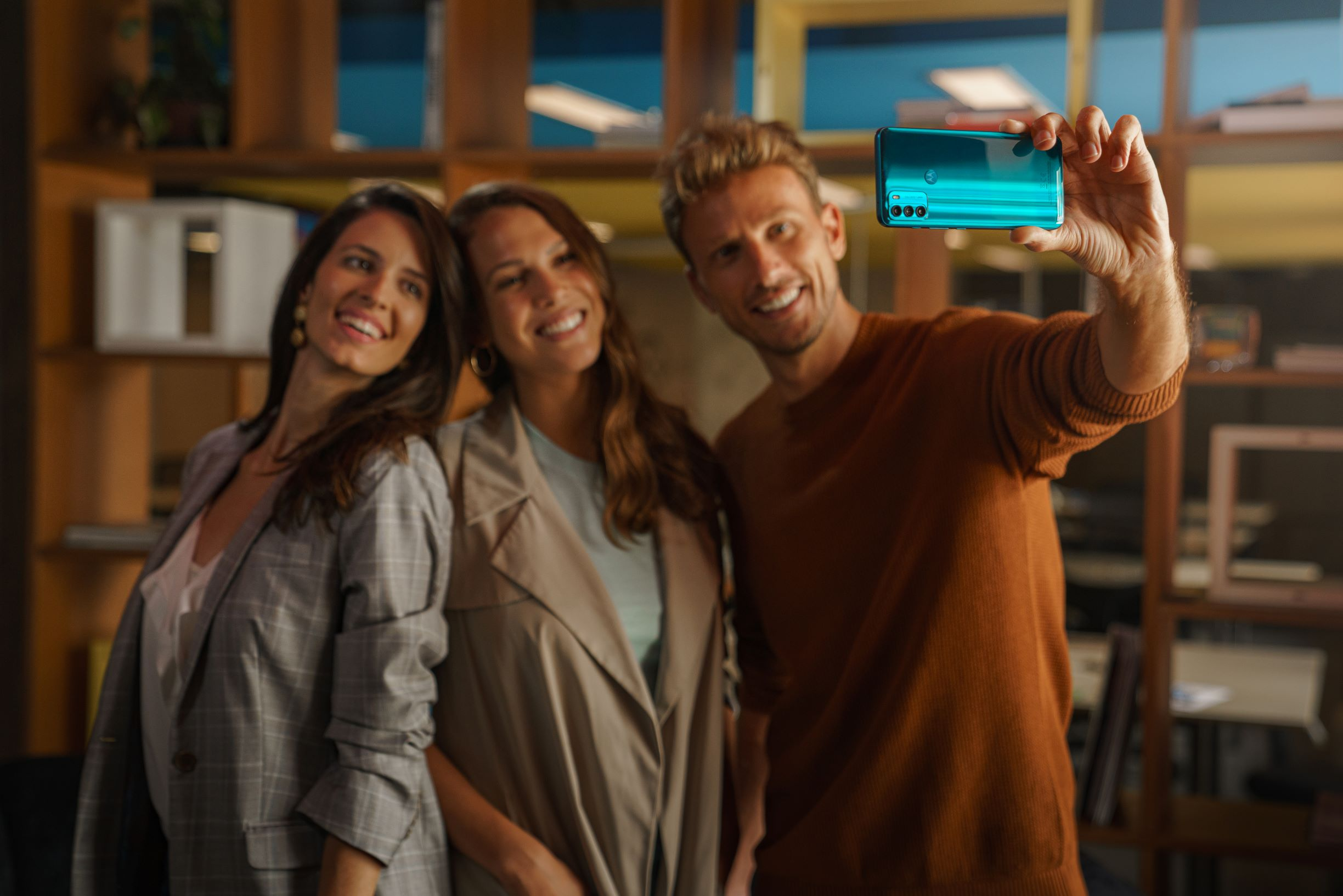 image of persons holding moto g50